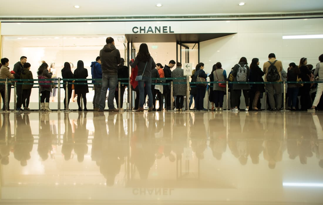 People queuing outside a Chanel store in downtown Shanghai.