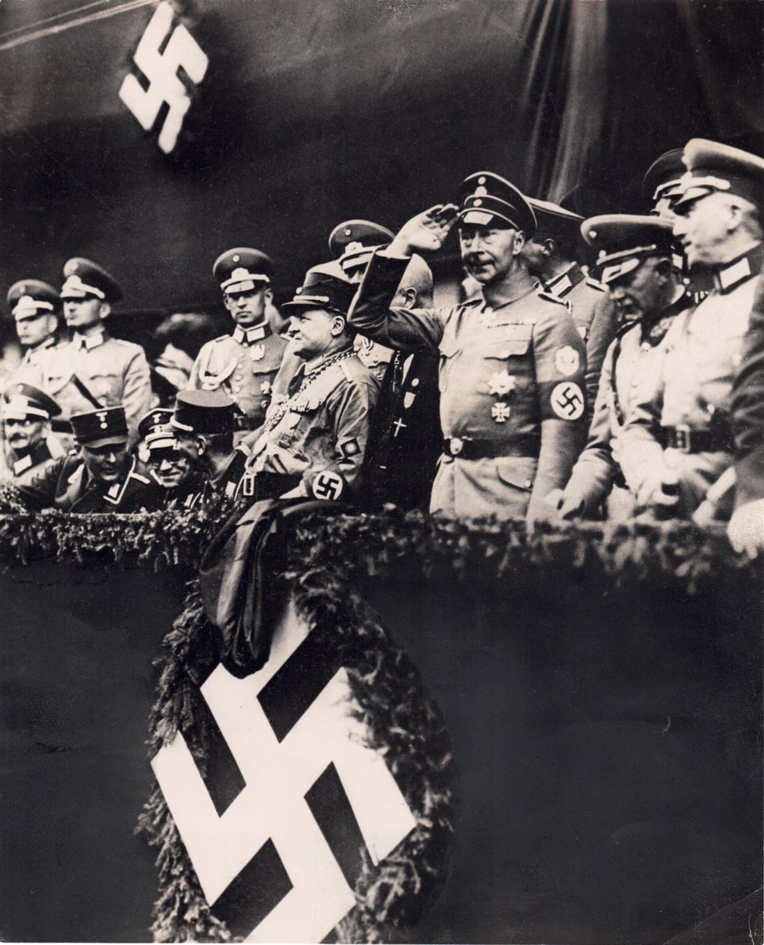 A photograph discovered by historian John Rohl shows Germany's former Crown Prince Wilhelm saluting at an SA rally in October 1933.