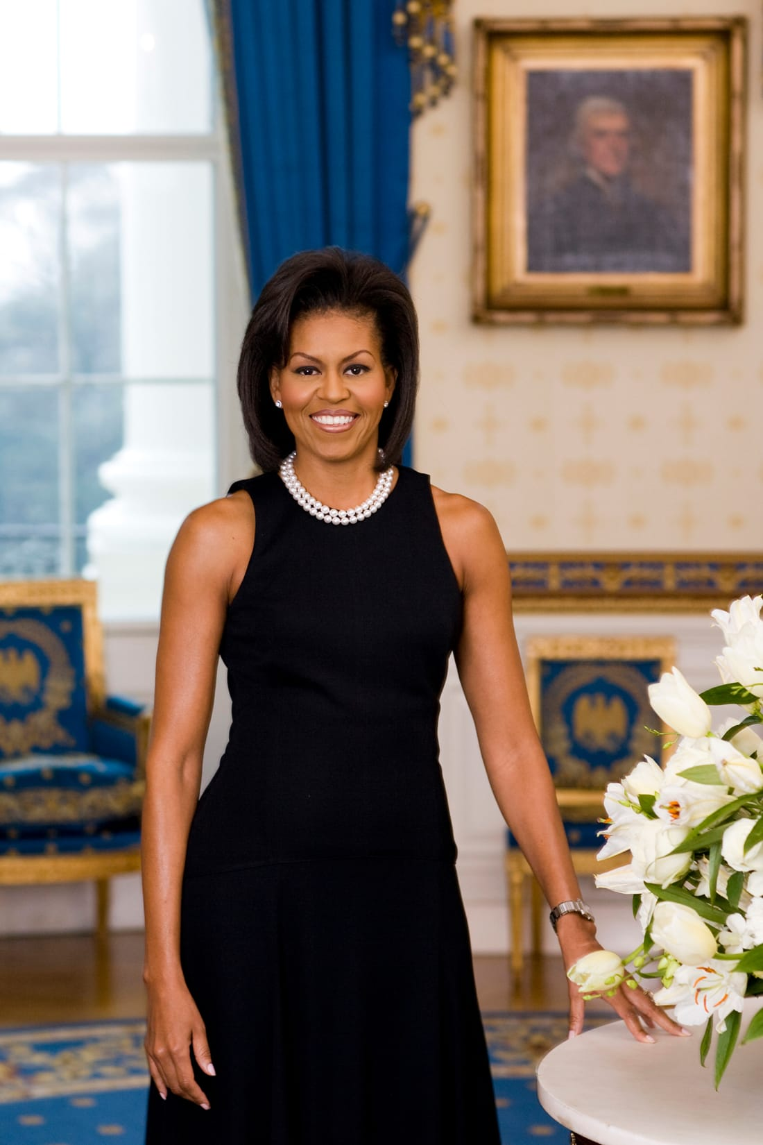 Michelle Obama poses for her official portrait in the Blue Room of the White House in February 2009.