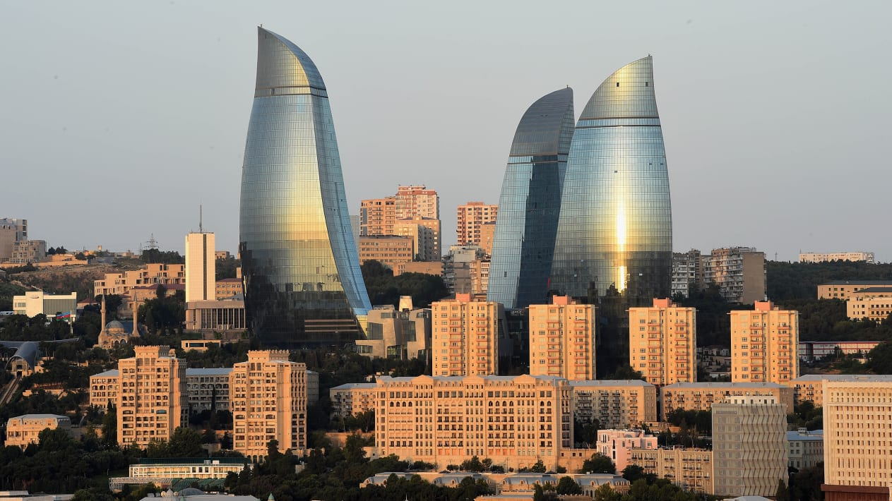 BAKU, AZERBAIJAN - AUGUST 04:  The Sun rise is reflected in The Flame Towers on August 4, 2014 in Baku, Azerbaijan.  (Photo by Christopher Lee/Getty Images)