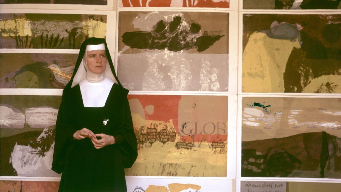 Sister Corita Kent in front of her pop art