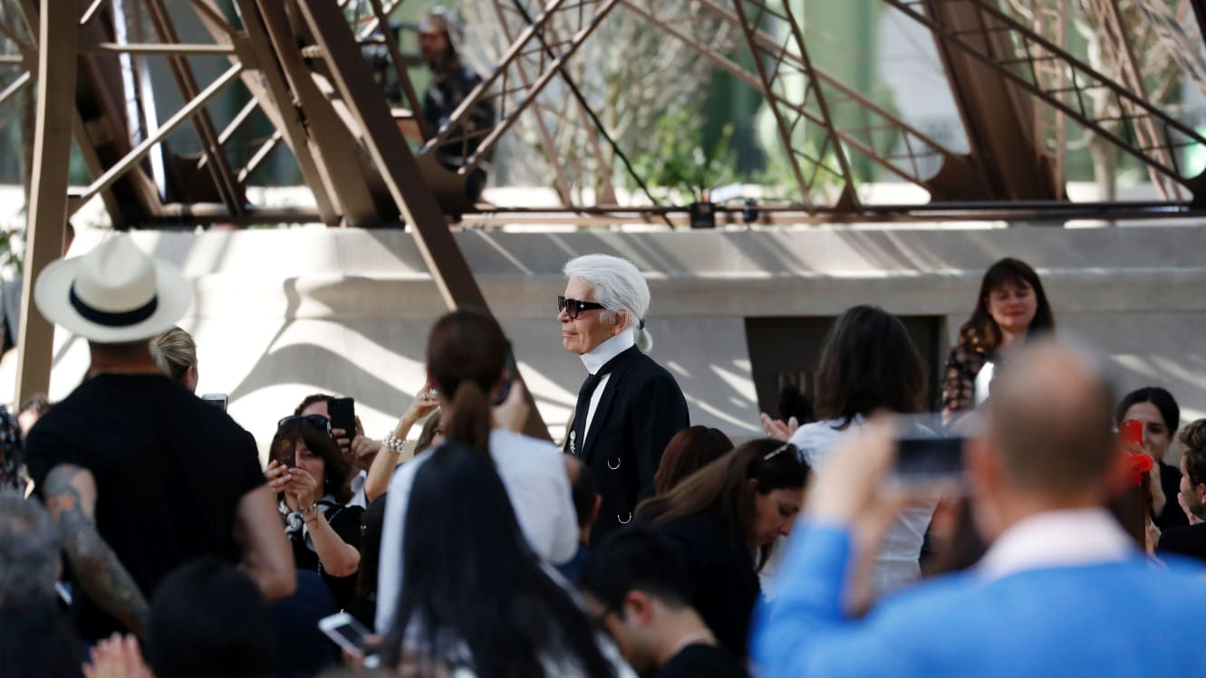 German fashion designer Karl Lagerfeld acknowledges the audience at the end of the Chanel 2017-2018 fall/winter Haute Couture collection in Paris on July 4, 2017.
