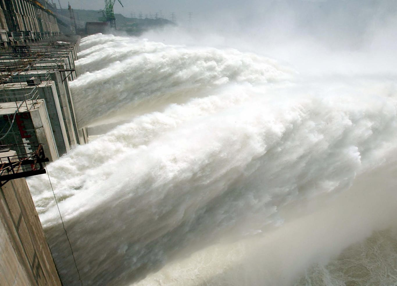 Water gushes out for the first time through the Three Gorges Dam on June 11, 2003.
