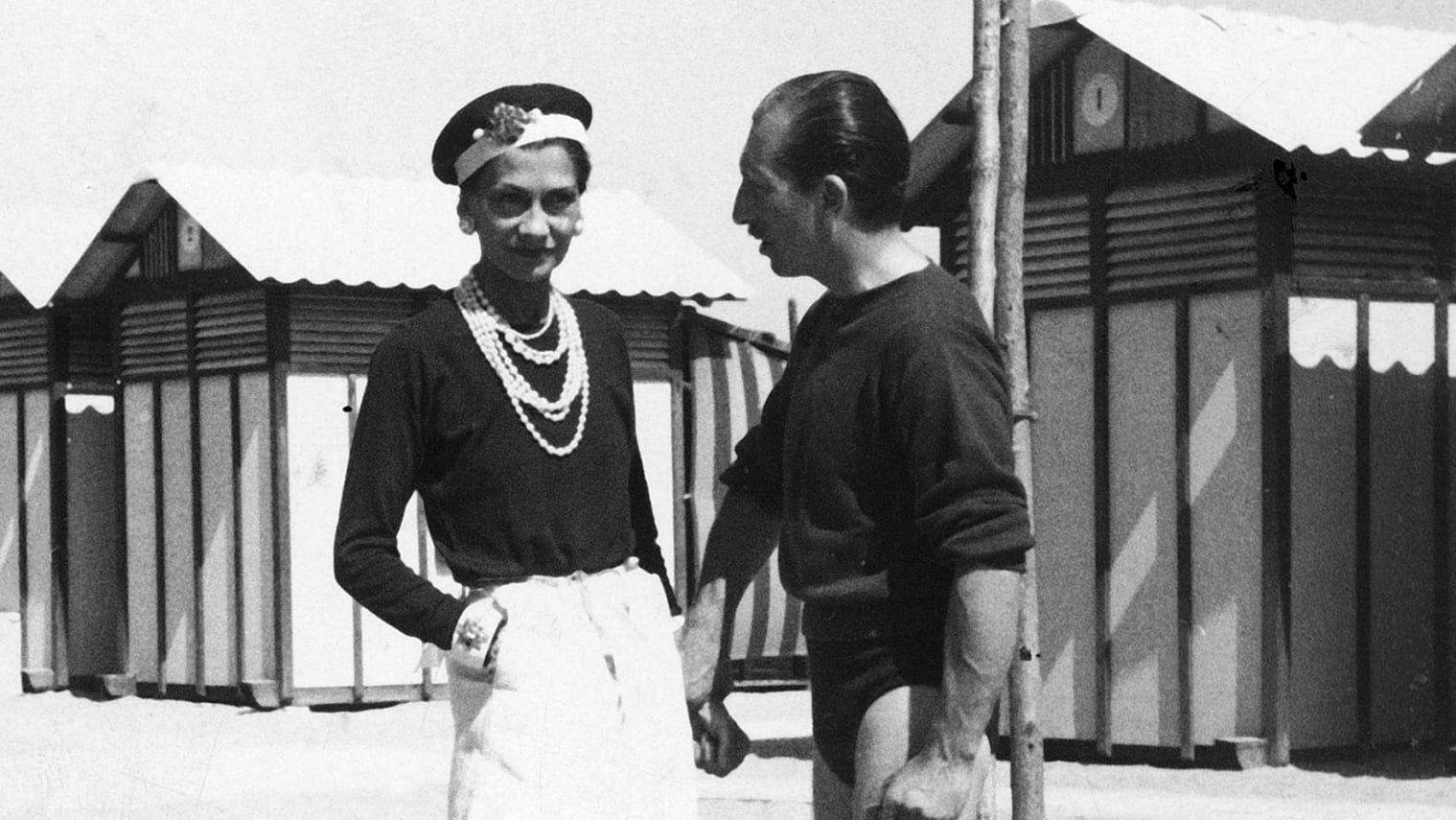 (L-R) Fashion designer Coco Chanel w. Duke Laurino of Rome on beach at the Lido.  (Photo by Time Life Pictures/Pictures Inc./The LIFE Picture Collection via Getty Images)