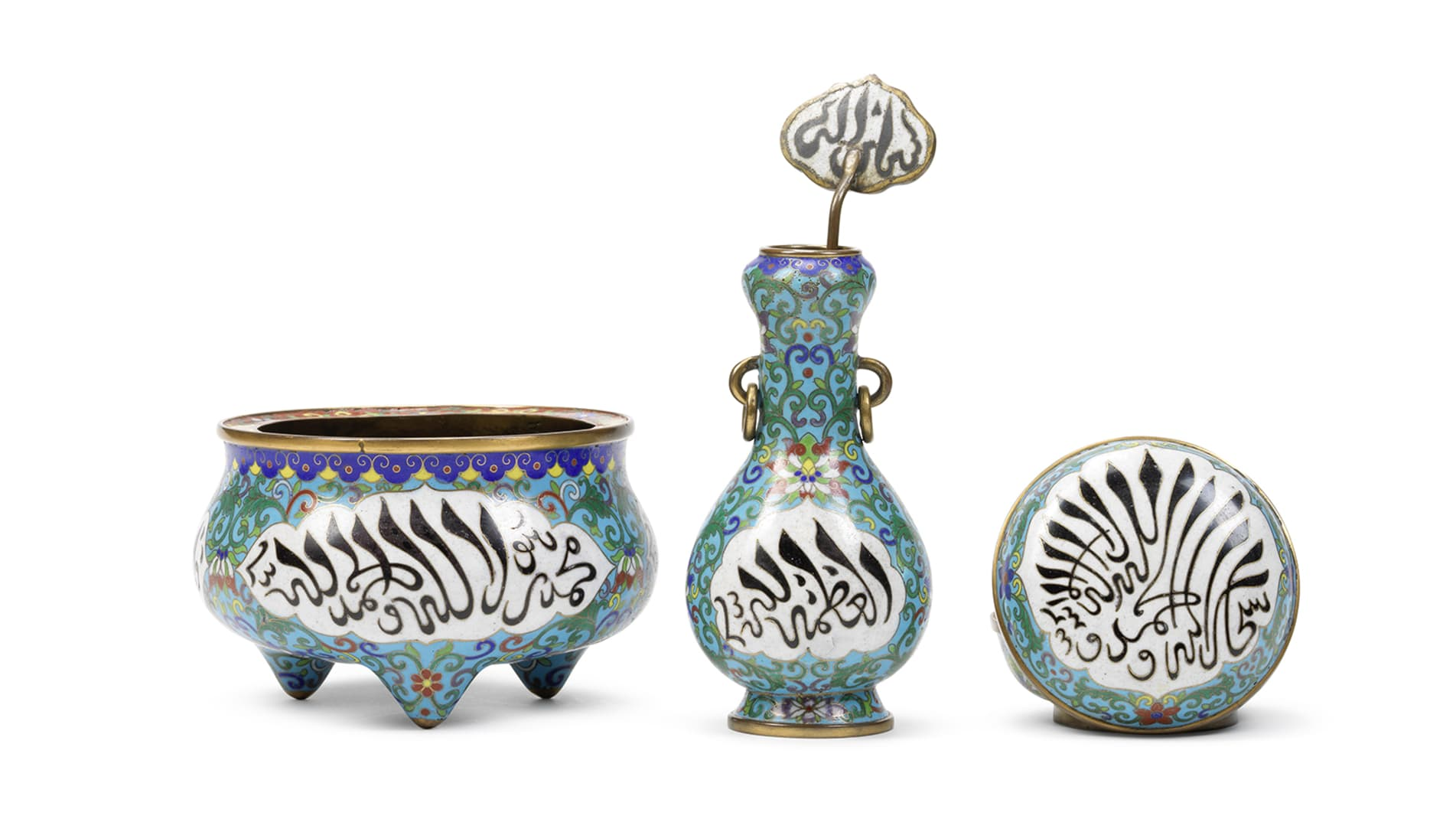 Used for storing and burning incense, this bronze altar set is inscribed with a stylized form of Arabic developed by Chinese Muslims.