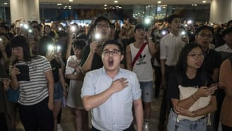 Demonstrators chant slogans during a flash mob at the International Finance Center (IFC) Mall in Hong Kong on Thursday, September 12, 2019.