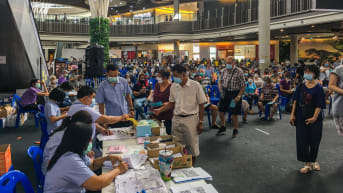 Mass vaccinations are now being carried out in Chiang Mai, including at the Promenada Shopping Mall, pictured.