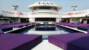 Without kids splashing about, the ship's pool area aims for well-being and tranquility.