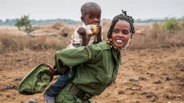 After four months in the field Ruth Sekeita Losiaik a member of the IFAW-supported Team Lioness, was reunited with her two-year-old son Bonham Shirim.