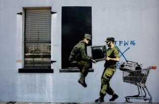 Banksy video reveals shredded artwork stunt did not go as