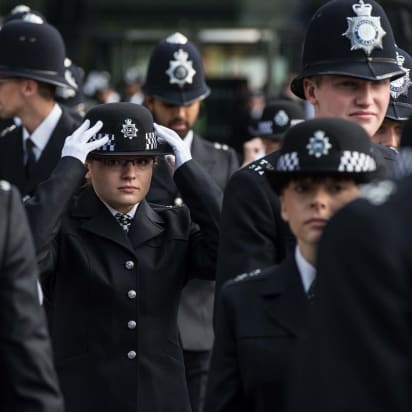 cfd09d84 A police cadet straightens her hat before the start of the Metropolitan  Police's 2016