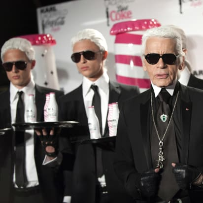 f7dfb89d66a German fashion designer and photographer Karl Lagerfeld poses with models  during the launch party of Coke