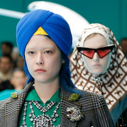 e3c1af97be A model wears a blue turban from Gucci's women's Fall/Winter 2018-2019  collection