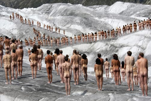 Naked volunteers pose for the US photographer Spencer Tunick in the ice-cold Swiss glacier of Aletsch, the largest in the Alps, as background for an environmental campaign about global warming in 2007.
