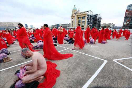 "Participants pose as part of Tunick's art installation ""Return of the Nude,"" on July 9, 2018 in Melbourne, Australia."