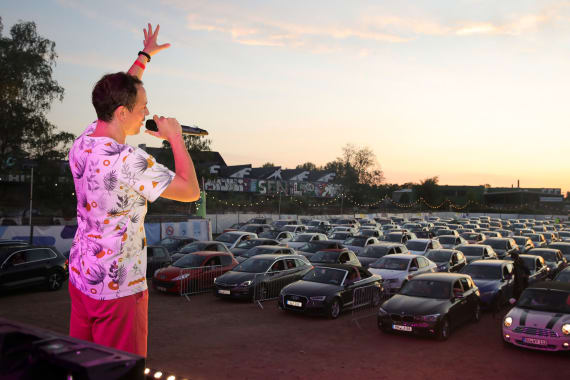 Drive-in events have expanded beyond movies to live music and theater. Here, 200 cars line up to see German DJ Alle Farben perform in Bonn, Germany.