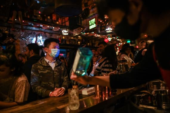 In Shanghai, nightlife staff wear masks and keep bars and clubs disinfected for patrons.