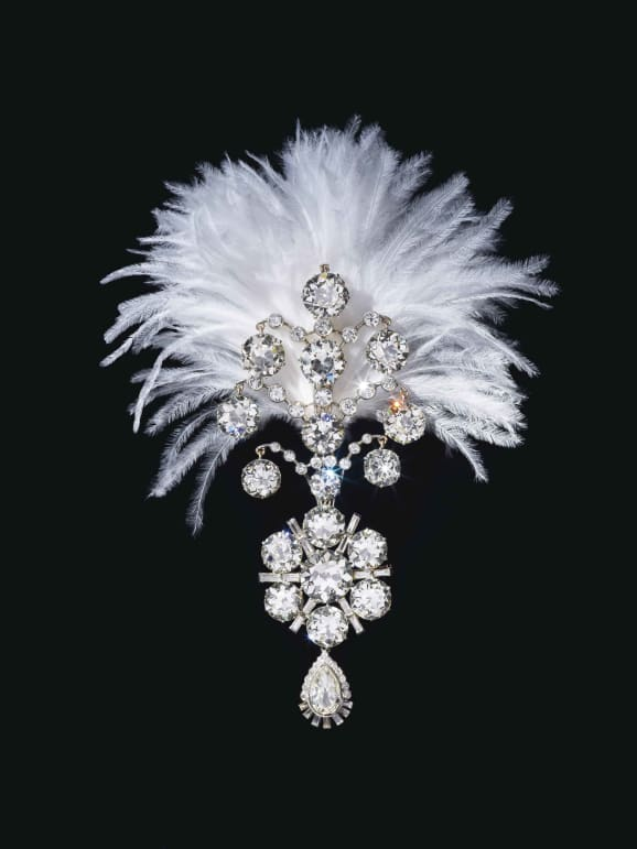 A Jigha, the turban ornament set with old, baguette and pear-shaped diamonds, white gold, fitted with plume holder on the reverse.