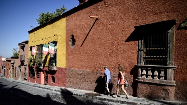 A colorful street in San Miguel de Allende, Guanajuato state, Mexico, attracts tourists from all over.