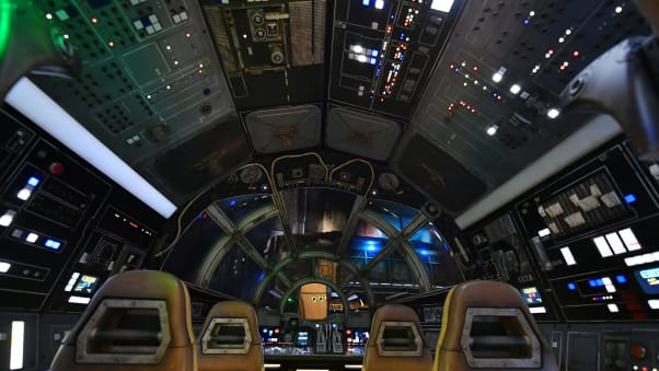 "Inside the Millennium Falcon cockpit where guests pilot the ""fastest hunk of junk in the galaxy"" on a dangerous cargo run."