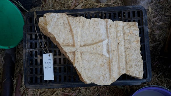 Among the other items recovered at the site was this remnant of a stone cross.