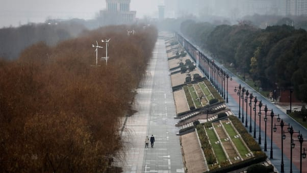 Two residents walk in an empty park during the Lunar New Year holiday on January 27 in Wuhan, China.