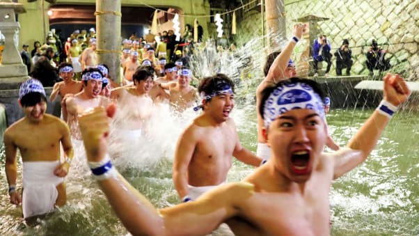 "Men in loincloths bathe in cold water to purify their souls as part of the ""Hadaka Matsuri"" (Naked Festival) at Saidaiji Temple on February 15, 2020 in Okayama, Japan."