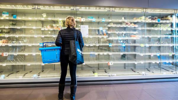 Shoppers are confronted with empty shelves at a supermarket on March 14 in Wassenaar, The Netherlands.