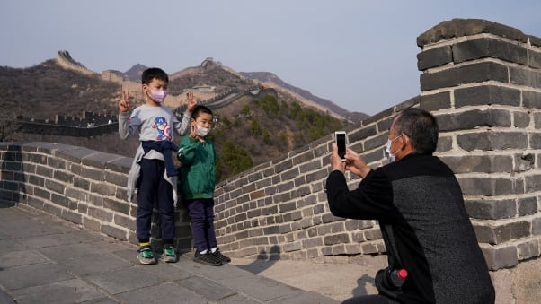 Children wear protective masks as they visit the Badaling section of China's Great Wall on March 24.