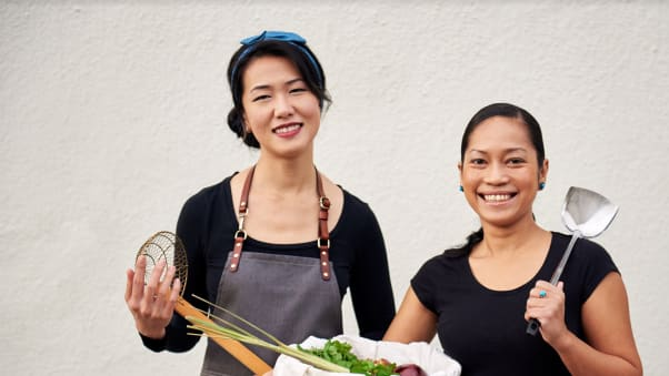 Indonesian chef Siska Silitonga (right) poses with Malaysian chef Tracy Goh (left).