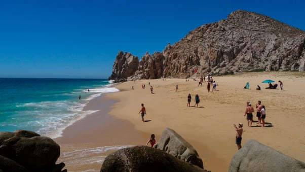 "Tourists sunbathe at the ""Love Beach"" in Los Cabos, Baja California Sur state, Mexico in March, 2018."