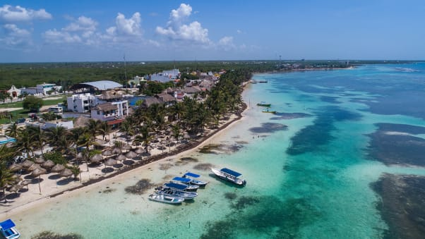 An empty beach in Mahahual, Quintana Roo, Mexico, may soon be filled with social distanced beachgoers.