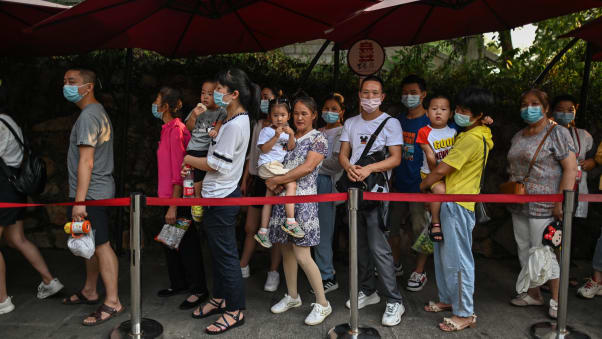 Tourists wearing face masks line up outside the Yellow Crane Tower in Wuhan, China on September 3.