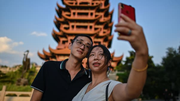 Tourists take a selfie at the the Yellow Crane Tower in Wuhan on September 3, 2020.