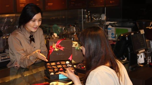 Buying handmade chocolate at Jubilee Chocolatier in Seoul.