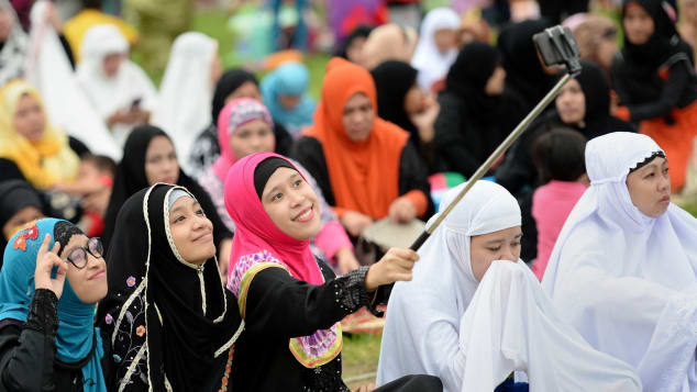 "Young Muslims devotees take a ""selfie"" prior to Friday prayers to mark the end of Ramadan last year in Manila, Philippines."