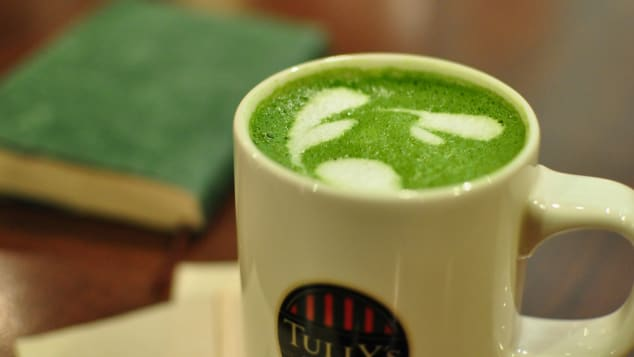 Milk and green tea in one cup.