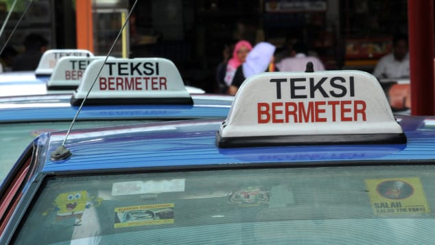 """Kuala Lumpur's taxis might advertise themselves as """"bermeter"""" (metered), but many drivers still refuse to switch them on."""