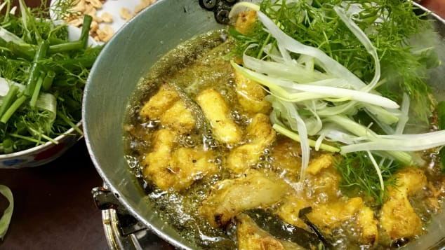 There's a street in Hanoi that's entirely dedicated to  chả cá --  a vermicelli noodle dish with turmeric-spiced catfish that diners grill themselves.