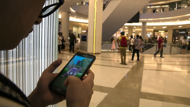 This shopper is more preoccupied with Pokemon Go than grabbing bargains.