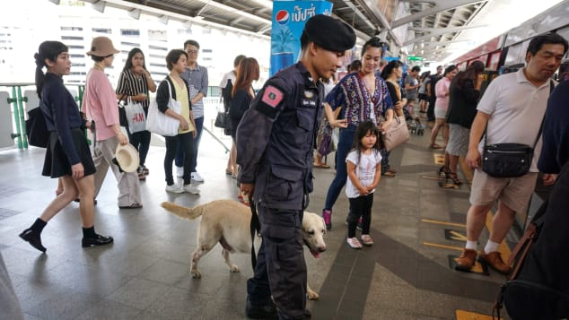 Thai policeman won't pass up on a chance to pounce on drug smugglers.