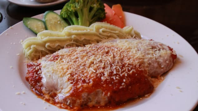 Australians have put their own stamp on chicken parmigiana.