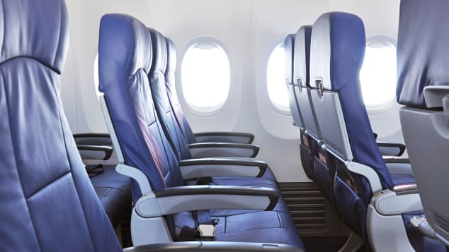 Tall people have a hard time with ever-smaller airline seats.
