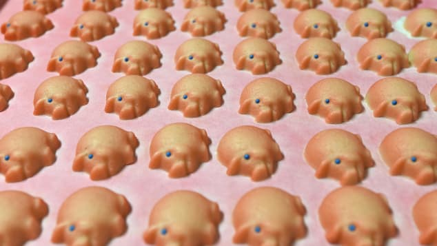 Fresh marzipan made in the shape of little pigges.