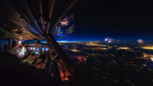 1 cockpit sunrise thunderstorms vanheijst_CNN
