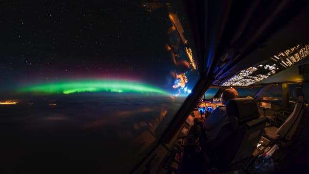 Northern lights over Canada and cockpit_CNN