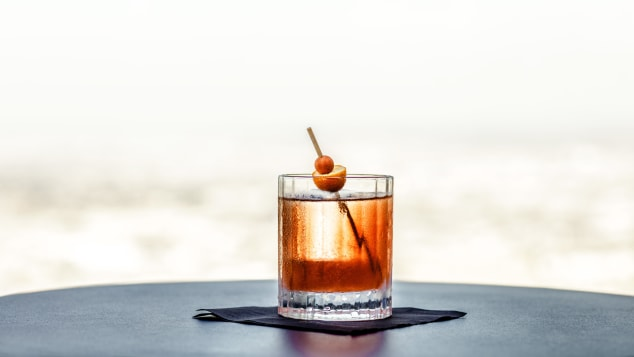 Spire73 makes its Kumquat Old Fashioned with Suntory Japanese whisky.