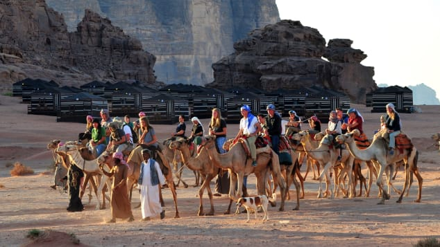 Local Bedouins take tourists on a camel ride through the Wadi Rum.
