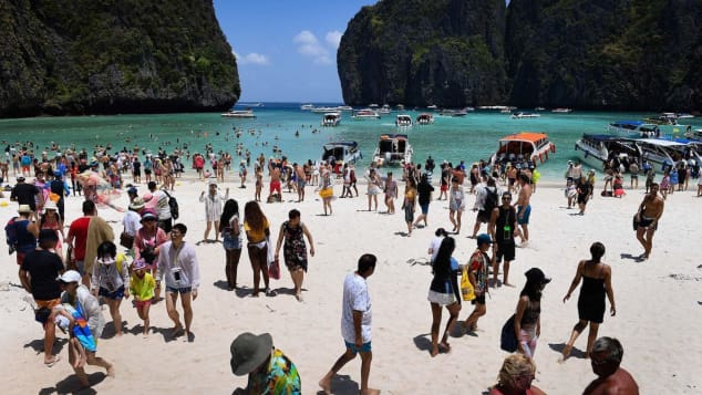 A crowd of tourists visits Maya Bay in April, 2018, prior to its closure.
