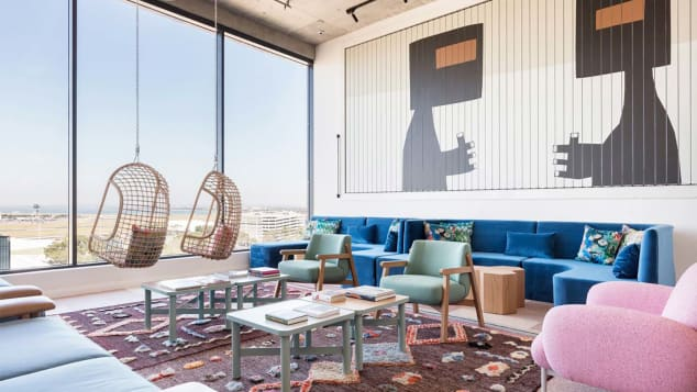 Take in the views from hanging chairs in the Penthouse lobby of Sydney's Felix Hotel
